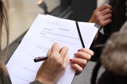 Picture of a woman filling out a survey.